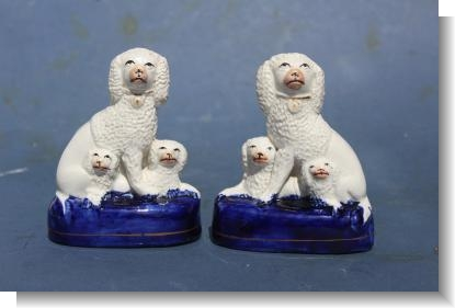 PAIR of SMALL STAFFORDSHIRE DOG GROUPS .1880